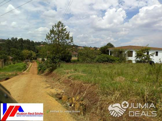 Half an acre on quick sale in kira